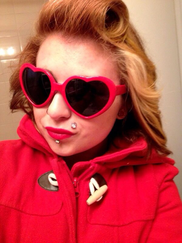 Copper with blonde chunk. Heart sunglasses. Red jacket