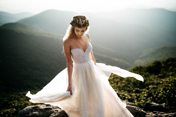 A flowy wedding dress is a must for a mountain elopement | Image by Julia Madden Sears