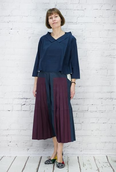 TM Collection elegant trousers in culotte style with some pleats. Woven cotton. Buttons to fasten at sides. These feel great and drape beautifully. 100% cotton, dry clean or handwash. Worn with Cotton top with relaxed V neck and collar, facings in contrasting colour. Roll back sleeves to show sulphur on plum and cream on inky blue. Lovely style.