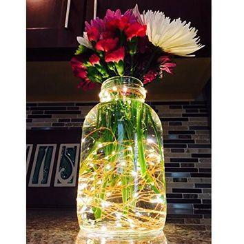 Led string lights in bottle as flower vase design let it glow.