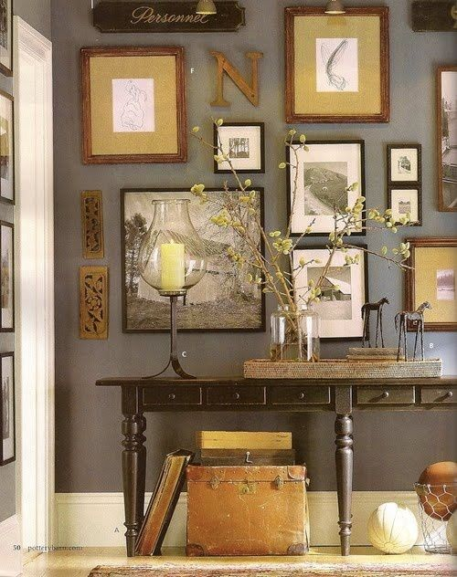 gallery wall, console table, great link of colour tone across timbers, frames and mounts.