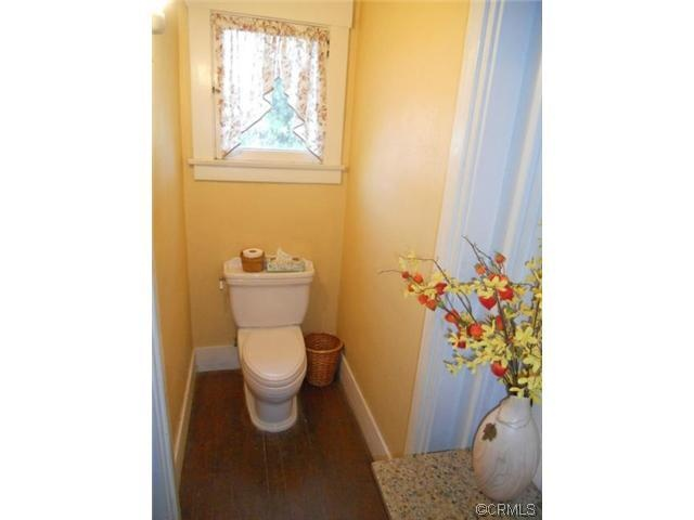 Sheer Curtains Lend Some Privacy While Retaining The Lightness Of This  Cheery Bathroom In An Arts