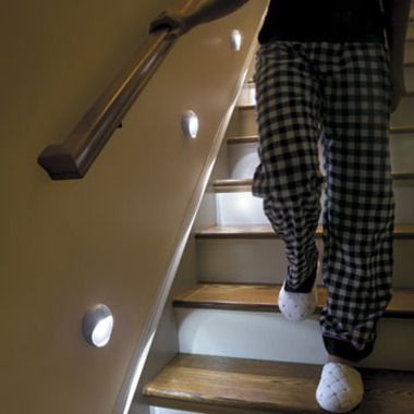 PathLights Wireless LED Stair Lights - Set of 3    Install the 3 motion sensor stair lights up to 18 feet apart on your stairs or in your hallway, using screws or mounting tape (both included). When you get within 6 feet of the first unit, the light comes on which then triggers the next unit to light as well. The PathLights Wireless LED Stair Lights stay on for about a minute, so you can safely make your way down dark staircases or halls. And since these motion sensor stair lights are…