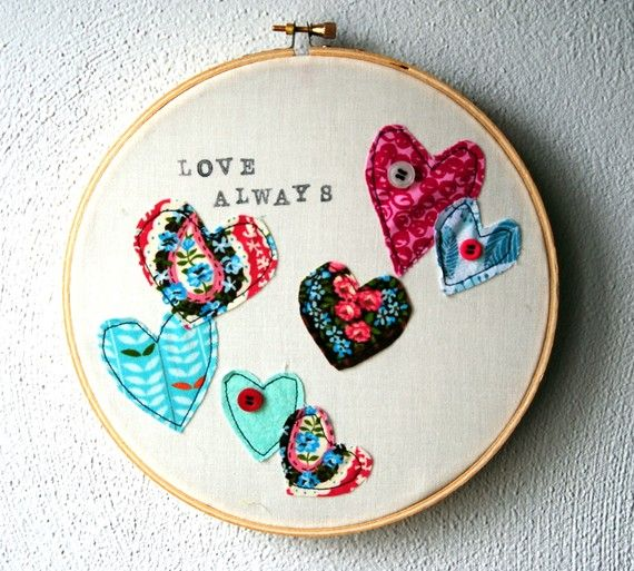 embroidery hoop art... instead of embroidering, I could use the hoops to frame the cute graphics from my my daughter's clothes that I'm saving.