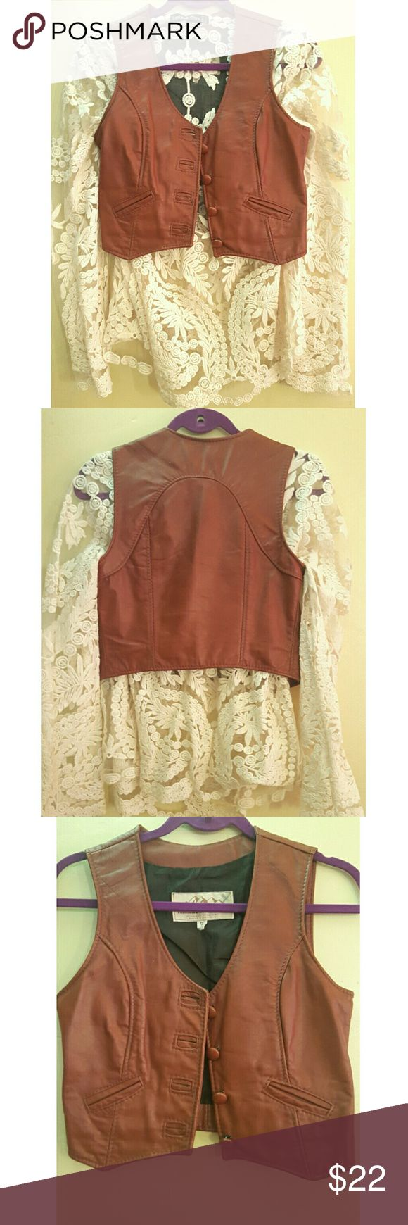 Vintage Leather cropped Western Moto Festival Vest Vintage brown / tan genuine leather button up vest for sale! Has 2 tiny front pockets.  Looks great over a long tunic for a super  gypsy boho look. The era I'm unsure of.  Looks to be from between the 70's to early 90's From a colorado leather company.   Says size 7, but fits like a 2 or xs! Colorado Trading Co. Jackets & Coats Vests