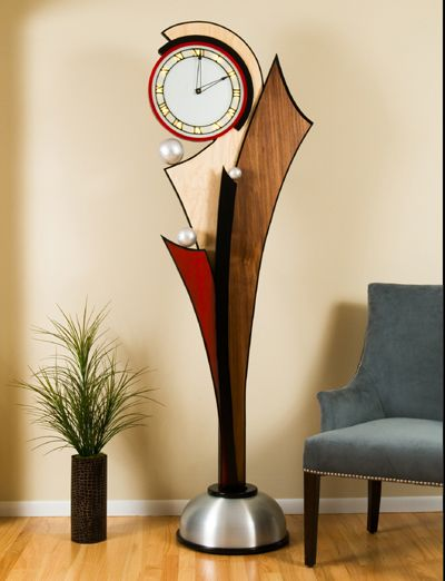 Springtime is handcraft in maple and aluminum with black accents. The face is frosted glass with backlighting. The aluminum accents on the flanges represent raindrops on a flowers petals.