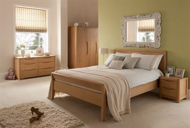 Stockholm - Subtle detailing, soft rounded corners and swept elliptical features are incorporated into the Stockhom to create an elegant bedroom range.     Crafted in American oak in a natural blonde finish, the Stockholm by Winsor includes bedframes, two and three door wardrobes, dressing table, bedside cabinets and four-drawer and six-drawer chests.   Dovetailed joints, soft-close drawers and doors, and aromatic cedar veneer-lined drawers give that extra touch of luxury.