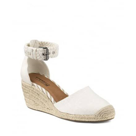 """In crisp linen with a braided rope ankle strap, these Sperry espadrille wedges have a classic nautical feel. Closed toe; buckled ankle strap2.5"""" wedge, 0.5"""" platform, feels like 2"""" wedgeLinen and leather upper, fabric lining, rubber soleImportedSize Chart:About Brand:About SperryPaul Sperry, founder of Sperry, was an avid sailor with a passion for adventure. He was an inventor, a sailor and an intrepid explorer. Anindependent spirit enamored with the power, freedom, and unlimit..."""