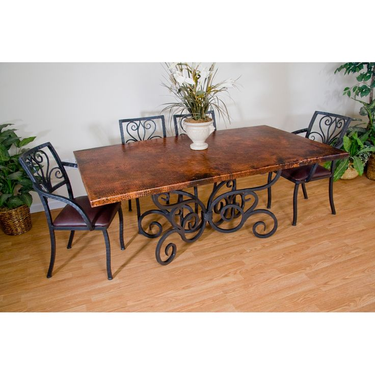 Alexander wrought iron dining table and arm chairs by for Ornamental centrepiece for a dining table