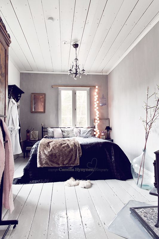 Cozy bedroom with white wooden floor