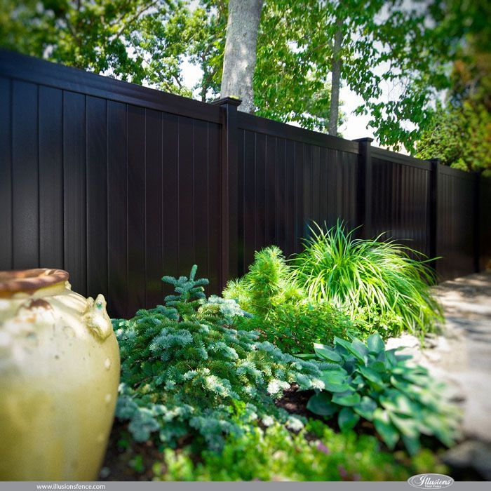 Looking for black PVC fence? V300-6 Illusions Vinyl Tongue and Groove Privacy Fence shown in the Grand Illusions Color Spectrum Black (L105).