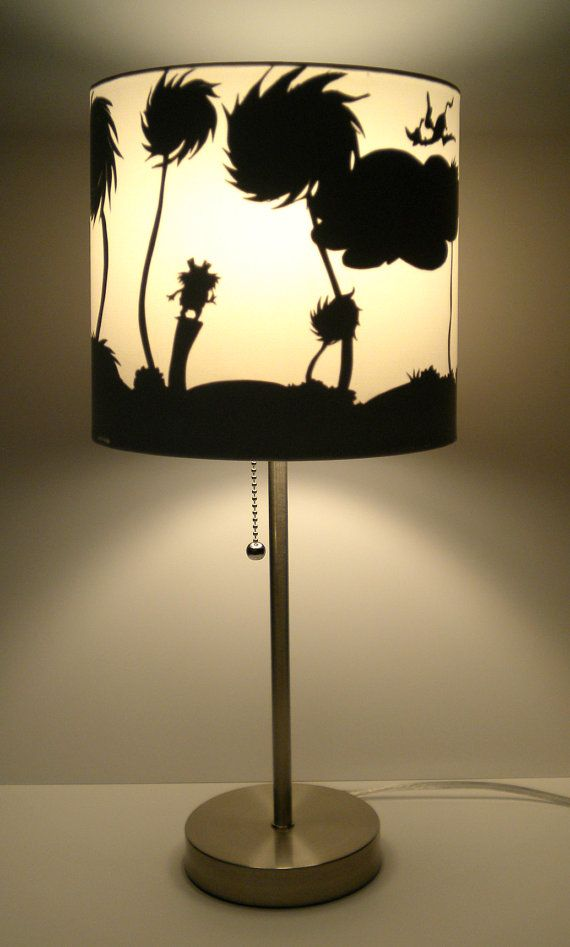 "This lamp has sold, but feel free to visit my Etsy shop and take a peek at my other designs, or request a custom designed lamp!  Silhouette Lamp by EnlightenedArt12, $65.00  Based on Dr. Seuss' beloved children's book ""The Lorax,"" this silhouette lamp features a landscape scene complete with truffula trees, The Lorax on his tree stump, the Once-ler's house, and a quote from the book, ""I speak for the trees!"""