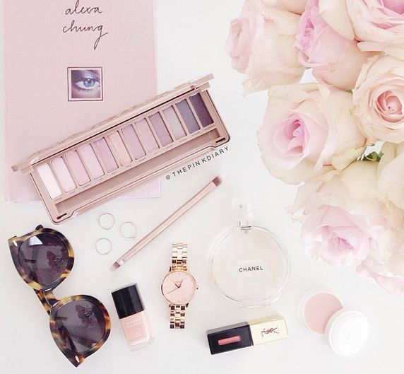 This photograph shows makeup, nail polish, sunglasses, a watch, a book, etc.