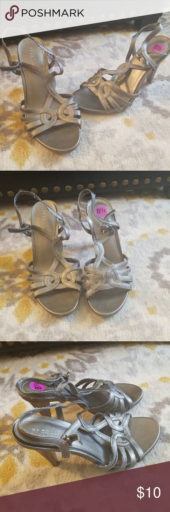 """Kenneth Cole Reaction Grey/Silver Open Toe Heels Kenneth Cole Reaction Grey/ Silver Strappy Open Toe Heels. Has a little sparkle to them. Style: Glow Know. Buckle closure. Good used condition with some minor wear or strings on straps, can be cut. Only worn a couple of times. Size 8.5. Heel height 3.75"""". Kenneth Cole Reaction Shoes Heels"""