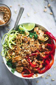 Use peanut butter, water, low sodium soy sauce, sesame oil, brown sugar, and spicy red pepper flakes to make a delicious creamy sauce for these Thai Peanut Chicken & Zucchini Noodle Bowls. | Le Creme de la Crumb