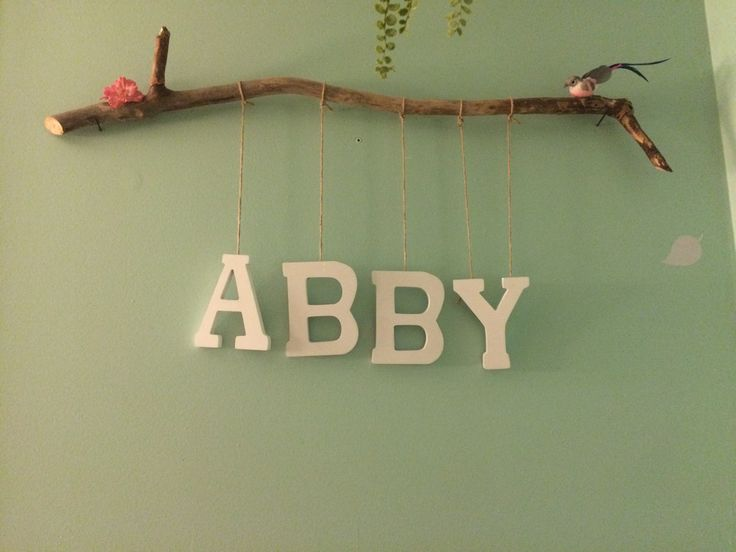 I like something similar to this. Probably a bulkier branch and maybe just a monogram...?