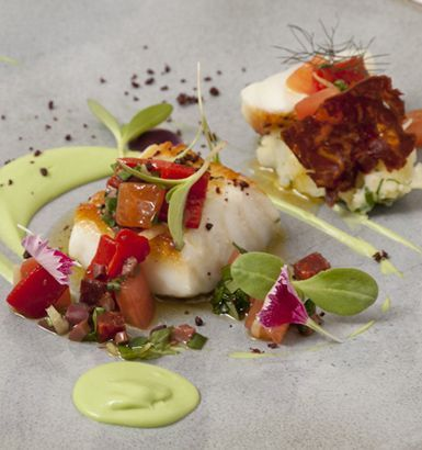 This exquisite cod recipe from Agnar Sverrisson of London's Texture is a delicious nod to the chef's Icelandic heritage. Icelandic cod loin is brilliantly combined with savoury chorizo and creamy avocado, with squid and olives in the sauce. With such a range of flavours, this cod recipe is unlike any you have experience before, and is an excellent dish in our seafood recipe collection.