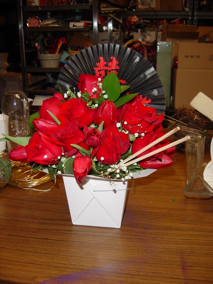 Having a Chinese New Year's party?  Make sure you waterproof a take-out box and then fill it with foam and red flowers.  I added a fan and chopsticks to complete the look. Designed by WhimsicalWelcomes.com