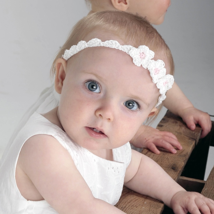 Little crocheted daisies on a handmade headband - perfect for little flower girls and weddings