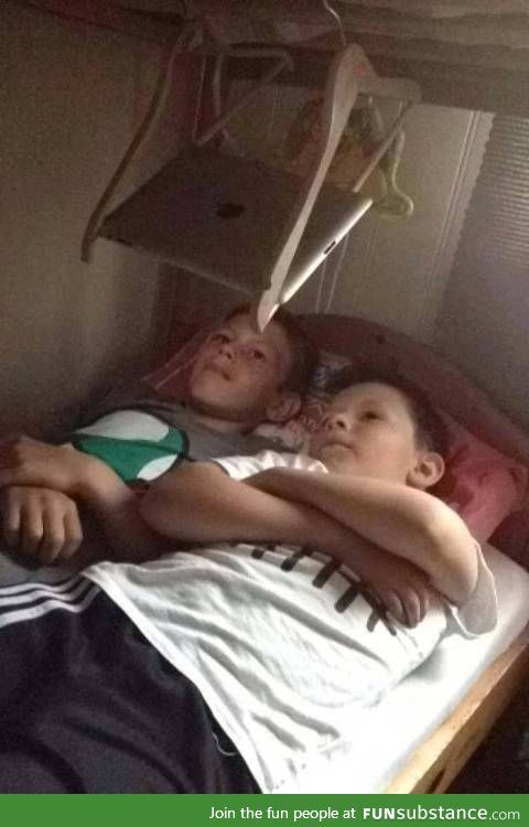 Kids invent iPad bed stand... Imagine what'll happen when that thing falls XP