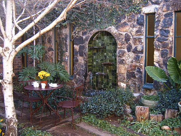 Breakfast table outside the guesthouse in the lush gardens of Klipriver Country Estate.