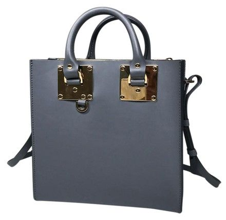 Sophie Hulme Charcoal Gray Grey Gold Saddle Leather Mini Albion Bg151le Tote. Get one of the hottest styles of the season! The Sophie Hulme Charcoal Gray Grey Gold Saddle Leather Mini Albion Bg151le Tote is a top 10 member favorite on Tradesy. Save on yours before they're sold out!