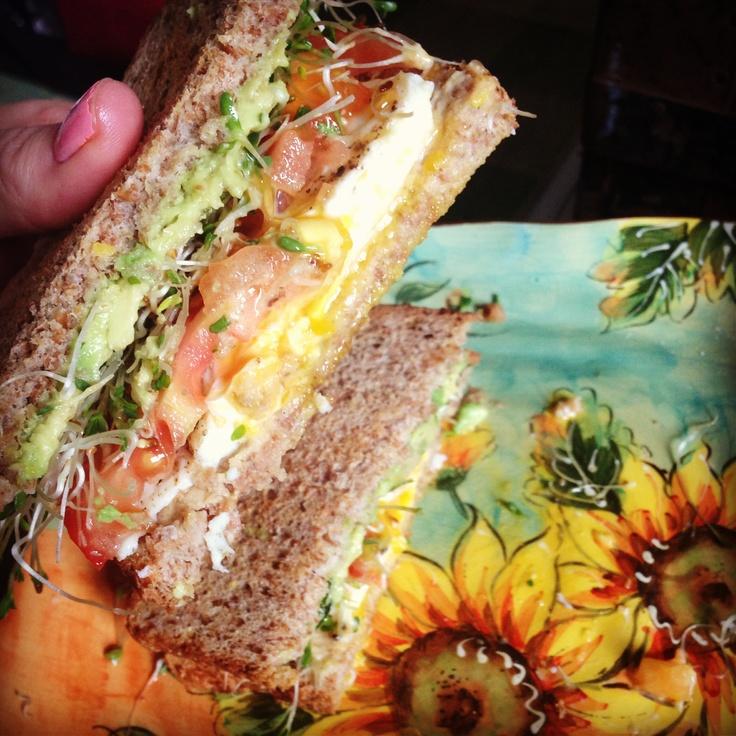 Lunch creation: Hummus, alfalfa, tomato, avocado, egg on Ezekiel bread! @Hannah Mestel Davis