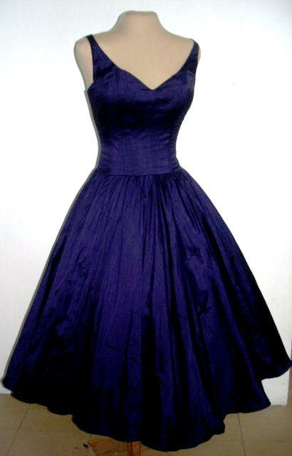 A sexy yet elegant 50s style cocktail dress in by elegance50s on Etsy.  MADE TO ORDER! $255.00