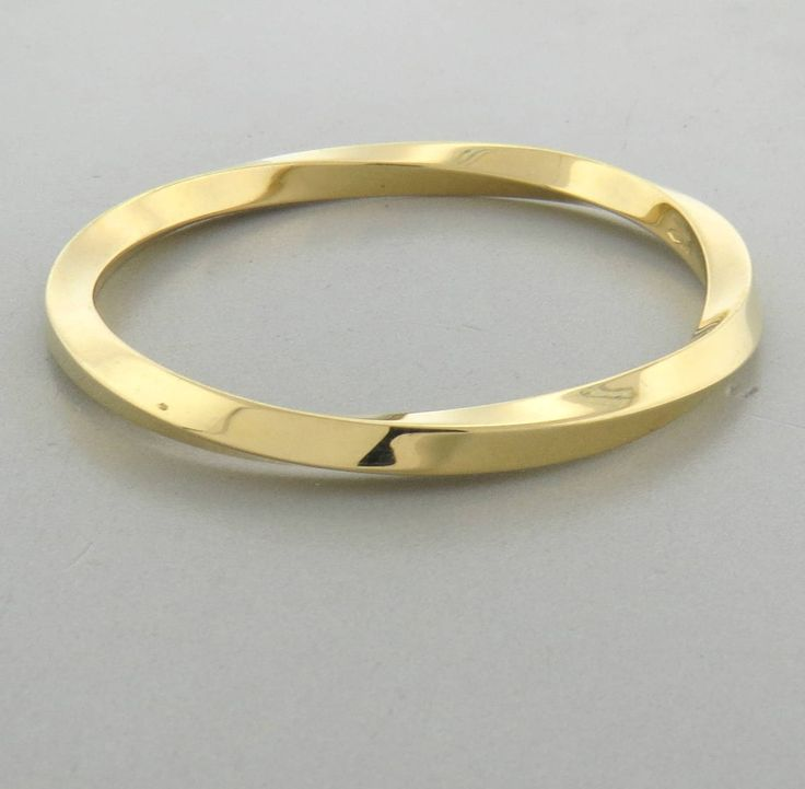 Tiffany & Co. Classic Twist Bangle Gold Bracelet | From a unique collection of vintage bangles at https://www.1stdibs.com/jewelry/bracelets/bangles/