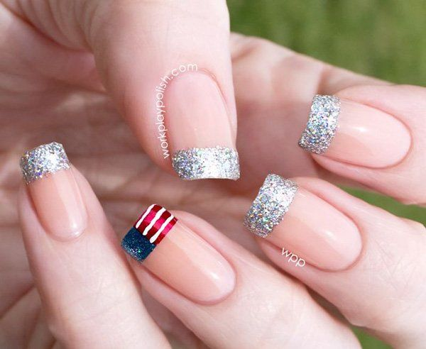 American and glitter inspired French tips. Coat your nails in matte cream color while tipping them with silver green sparkles and the American flag with sparkles on the blue polish.
