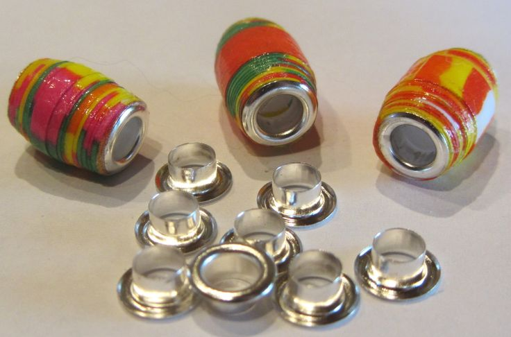 Here is a way to gloss your paper beads with Modpodge and insert and glue a metal type bead core to paper beads.