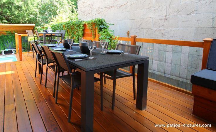 Dining area with table for 6 to 8 people and railing with for Glass deck floor