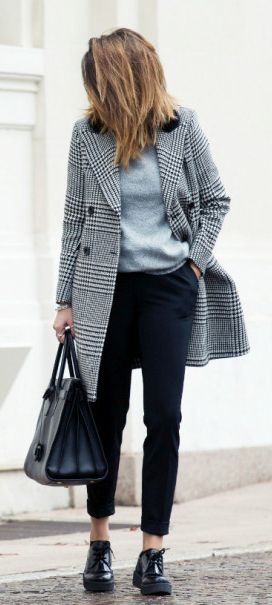 Nicoletta Reggio is wearing a black and white plaid coat from Sacai