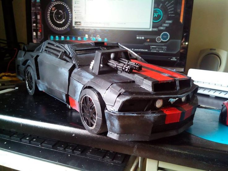 A Death Race Mustang car made of paper with miniguns, it's templates are available to download for free at the following link: