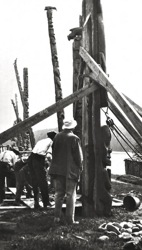 At the top of the pole is the Supernatural-Frog, followed by Man-Cut-in-Half and then the Frog, which has its head facing up between the arms of the Man-Cut-in-Half.<br><br>This pole is being re-erected as you can see the foundation being prepared for the pole. This was originally a house frontal pole that is now destroyed.
