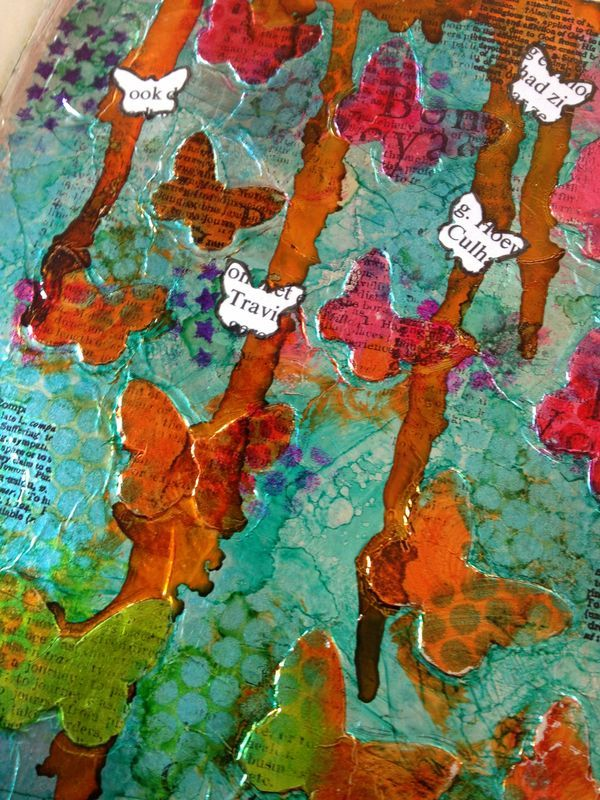 "Love this look for art journaling. ""For this page I punched a bunch of butterflies from cardstock and glued them on my page. Then I covered the whole page with an adhesive sheet from Scrapbook Adhesives by 3L and carefully layered the tin foil on top. I rubbed the tin foil gently with a cloth to make the butterflies under neath pop up."""