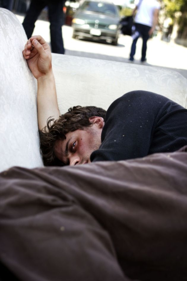 Francois Arnaud from The Borgias poses as a rough sleeper for the What Makes Us Care? exhibition to raise awareness of the rising number of ...