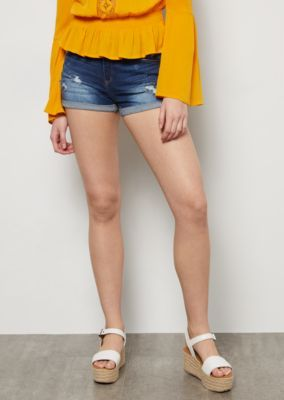 f52f34665d A pair of dark wash jean shorts outfitted with a mid-rise waistline,  distressing