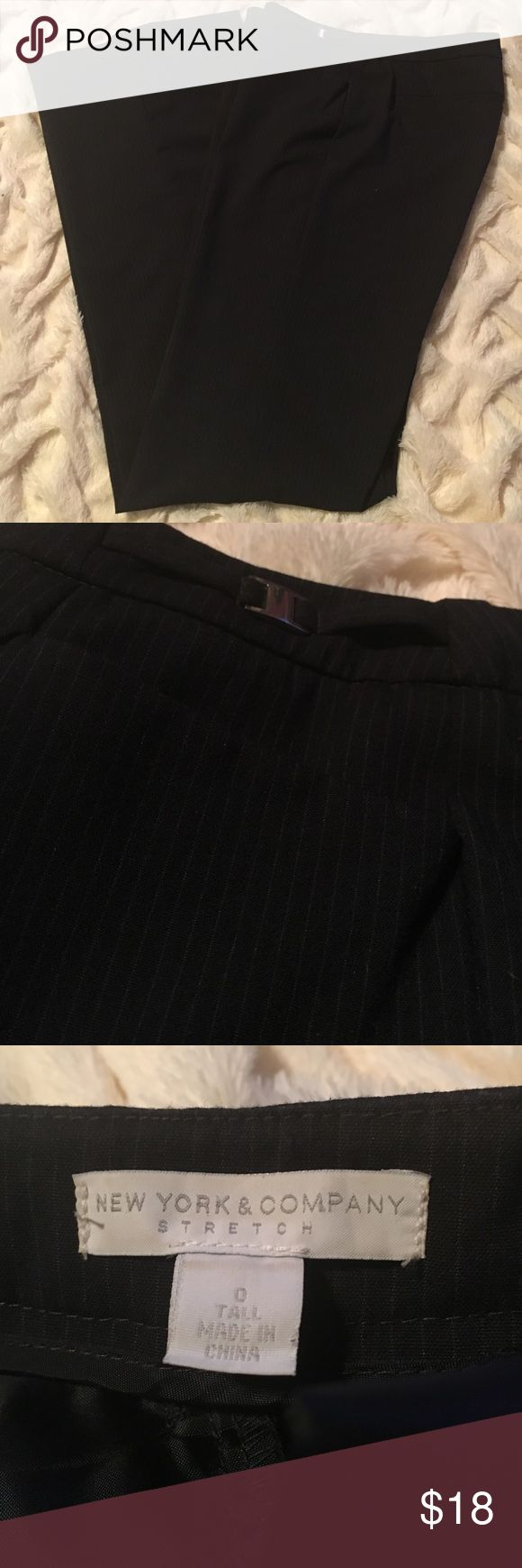 NY&Co navy blue pinstripe dress pants, size 0 Tall These NY&Co dress pants are dark navy blue with a lighter blue pinstripe. Size 0 tall. Only worn once..in like-new condition. Non-smoking home. New York & Company Pants Trousers