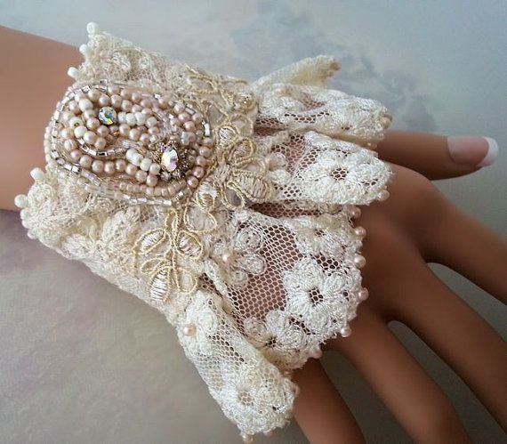 A vintage lace cuff bracelet with glass pearls, seed beads and sparkly Swarovski crystals. All hand-embroidered to the lace in various hues of cream.
