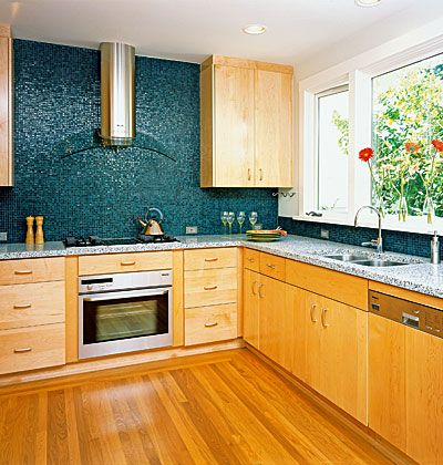 Minimalist Kitchen with Green Tile Backsplash