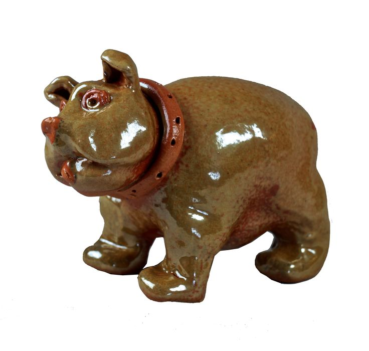 """LIL' BULLDOG - HAND BUILT STONEWARE DOG SCULPTURE  (Free shipping in the lower 48 States only)    We are offering for sale an adorable hand built stoneware sculpture of a LIL' BULLDOG WITH COLLAR. The dog is in a rich shino glaze with a wax resist collar. He measures approximately 3.5"""" wide x 5.75"""" long x 4.5"""" high. It is signed underneath on his belly.    This wonderful little fellow is a one of a kind sculpture made by Palm Springs California ceramicist David R. Farnsworth. David is also a…"""