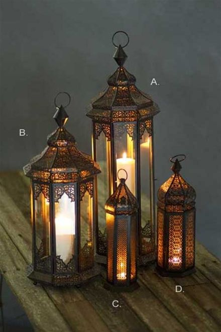 "Bring a warm amber glow to your porch or hearth with these gorgeous metal Moroccan lanterns, rich in detail with dark bronze coloring. Only available in Extra Small (size C). Dimensions: 4.25"" dia x 1"