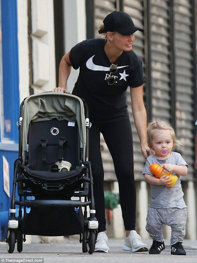 Big steps: During a family outing in New York last week, Lara Bingle and Sam Worthington's one-year-old son Rocket walked alongside his famous mother