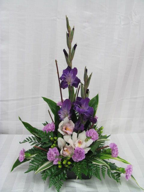 Glads, orchids & moon carnations. www.carolynsfloraldesigns.com