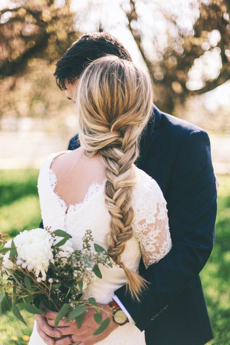 love this loose braid for a more casual but elegant wedding day look