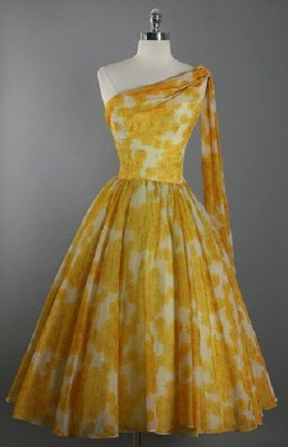 1950's yellow and white chiffon scarf cocktail party dress, with a flattering silhouette, fitted bodice, draped neckline, one shoulder scarf, and full skirt. by Fred Perlberg.