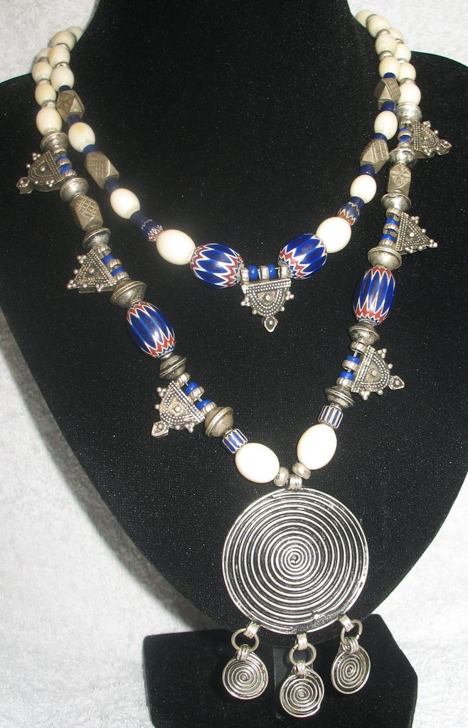 DrSpeck's Designs | Antique African Ivory beads (mid to late 1800s), Venetian 6 layer chevrons (ca 1900), Antique Berber silver beads, Antique Ethiopian silver pendants, 7 layer chevron bead (ca 1950) and a variety of other old glass beads ranging from 1950 to the early 1900s.
