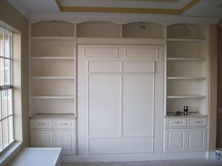 this custom murphy bed unit was built into a craft room