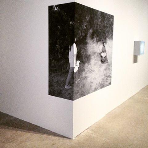 Photo print decal wrapped around corner - photography exhibit design ideas